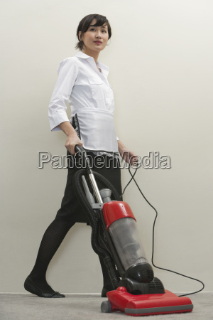 full length of young female housekeeper