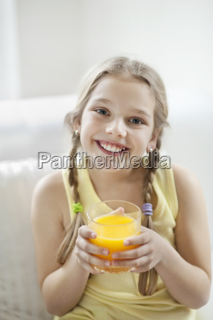 portrait of happy young girl drinking