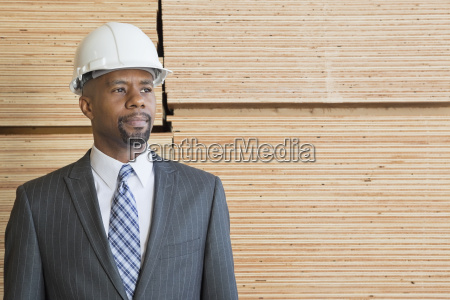 confident african american male contractor looking
