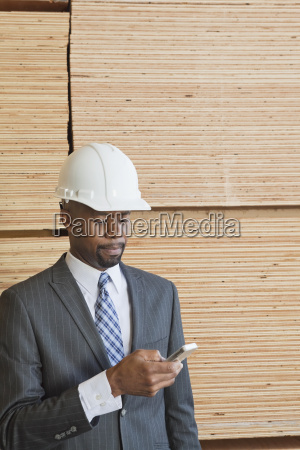 african american male engineer using cell