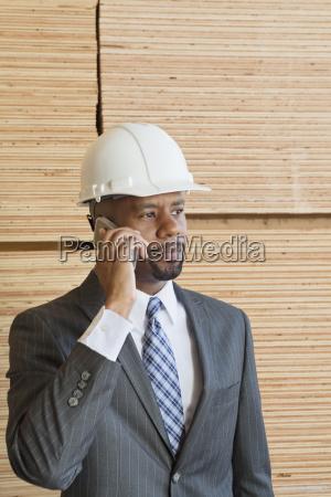 african american male engineer on phone