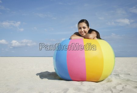 teenage girl relaxing on large colorful