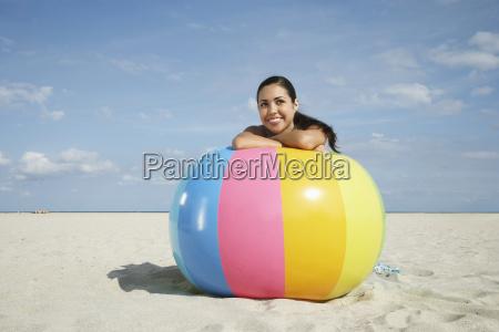teenage girl relaxing on colorful beach