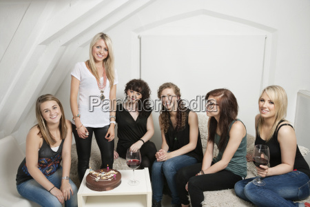 female friends celebrating young womans birthday