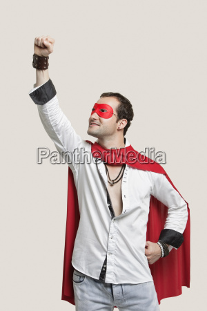 young man in superhero costume standing
