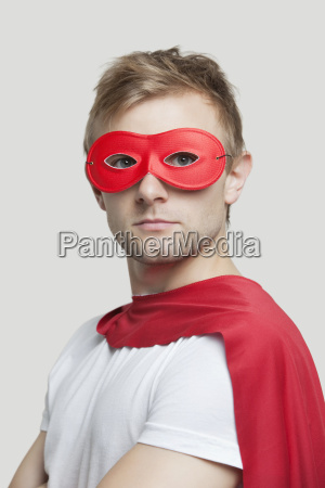 portrait of young man wearing superhero