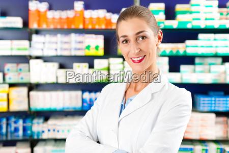 female pharmacist in pharmacy