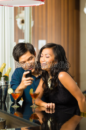 asian man is flirting with woman