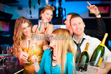 people in club or bar drinking