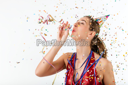 woman celebrating birthday with streamer and