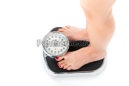 young woman standing on a scale