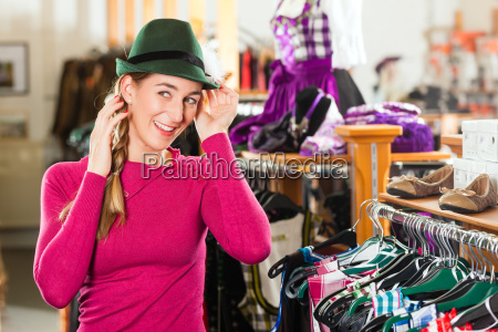 woman is buying a cap for