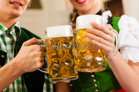young couple in traditional bavarian tracht