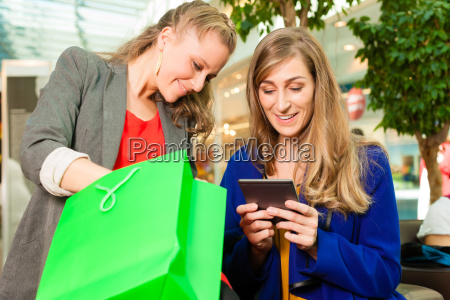 two women shopping with bags in
