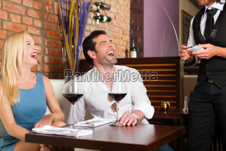 attractive couple drinking red wine in