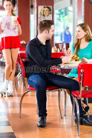 people in american diner or restaurant