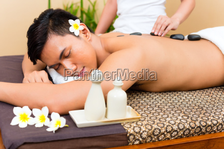 indonesian man at hot stone wellness