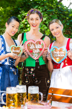 women in traditional bavarian clothes in