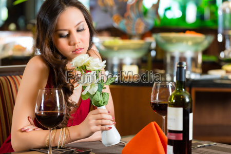 chinese woman waiting in restaurant for