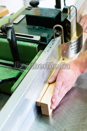 carpenter with electric cutter
