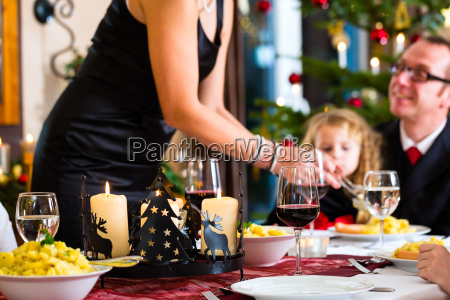 family having christmas dinner sausages