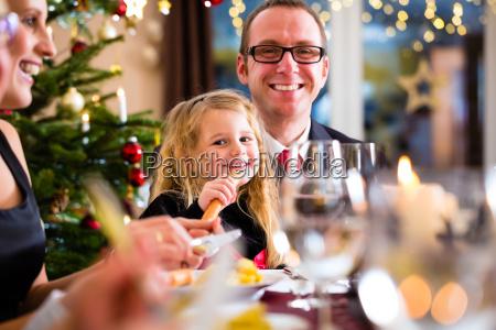 family eating christmas dinner at home