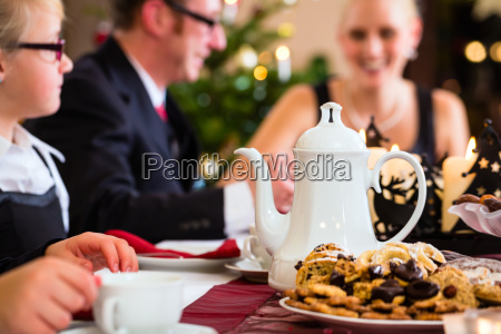 family having traditional christmas coffee drinking