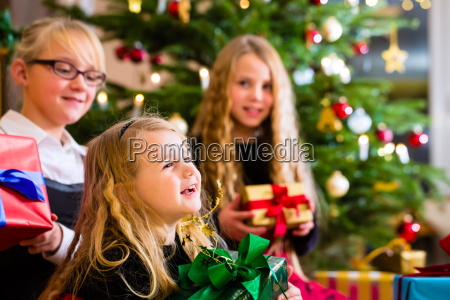 children with christmas gifts on christmas