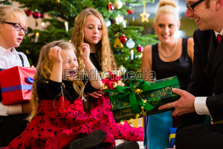 family with presents on christmas day