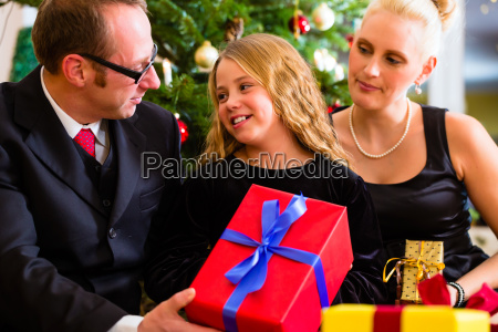 family with christmas gifts on boxing