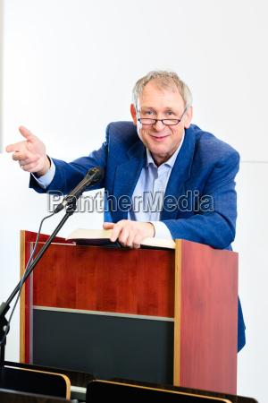 college professor giving lecture