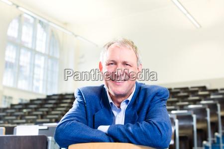 college professor in auditorium