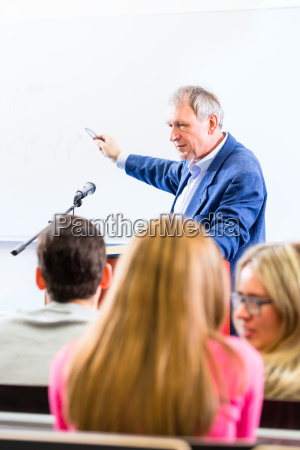 college professor giving lecture for students