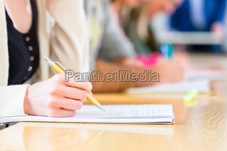 college students writing test or exam