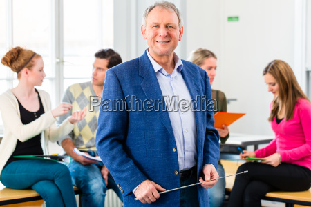 college professor in class with students