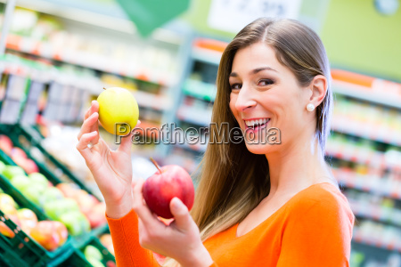 woman selecting fruits in supemarket