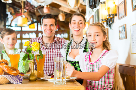 bavarian girl with family in restaurant