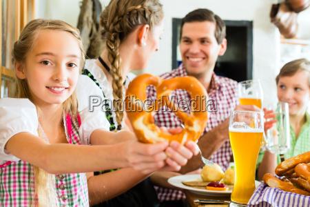 bavarian girl with family in restaurant