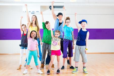 dance teacher giving kids zumba fitness