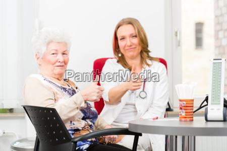 doctor seeing senior patient in practice
