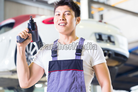 car mechanic with tool in asian