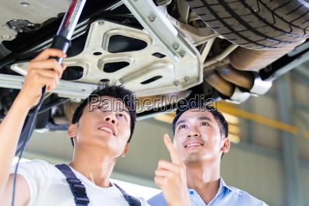 car mechanic and customer in asian
