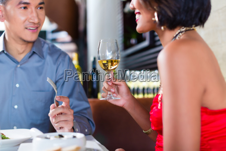 asian couple fine dining in restaurant