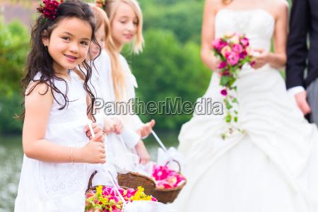 wedding bride and groom with bridesmaid