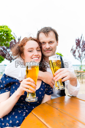 man and woman drinking in beer