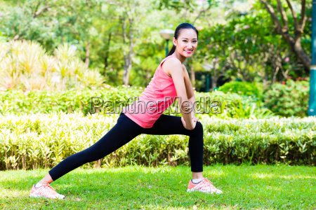asian chinese woman at outdoor fitness