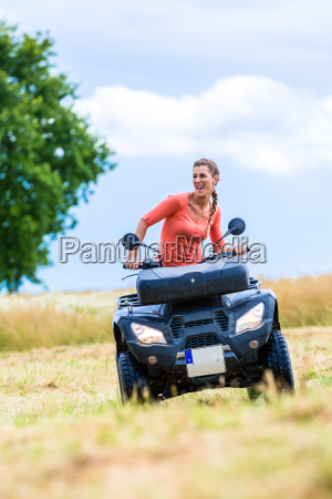 woman driving off road with quad