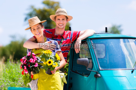 couple in garden with flowers on
