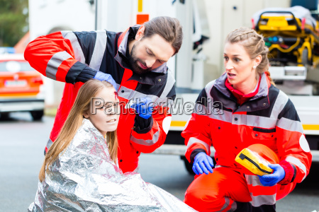 ambulance doctor helping injured woman