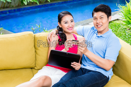 asian couple shopping online in internet
